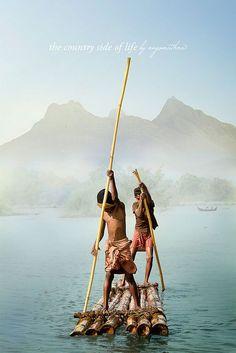 Boys on a Bamboo Raft, Kerala, India