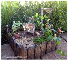 This is such a cute faerie garden, I particularly love the tire swing!
