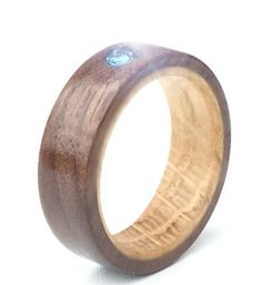 A natural wooden engagement ring- to find out more visit http://www.wooden-rings.com/show_product.php?products_id=118
