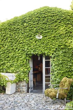 Owen created six stone buildings inspired by ones she saw in Provence. Outside the ivy-clad dining pavilion, an antique stone sink from France was repurposed as a fountain, and a needlepoint chair from a consignment store is covered in live moss. Patio Roof, Pergola Patio, Backyard, Pergola Swing, Cheap Pergola, Vine Fence, French Bistro Chairs, Patina Farm, Corner Pergola
