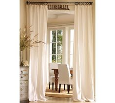 drapes to separate a room - a temporary solution/idea until we decide what we want to do between kitchen/living room (or use the IKEA panel curtain - http://www.ikea.com/us/en/catalog/products/80078132/).