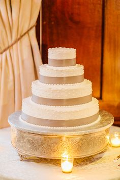 Four-Tier White Cake with Gray Ribbon and White Piping