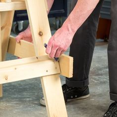 Build this ingenious, handy, adjustable sawhorse in a few hours to add to your jobsite arsenal. You can build a pair this weekend! Sawhorse Plans, Workbench Plans Diy, Workshop Storage, Craft Room Storage, Paper Storage, Garage Workshop, Craft Organization, Lumber Storage, Tool Storage
