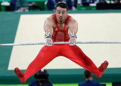 Britain's Kristian Thomas performs on the horizontal bar during the artistic…