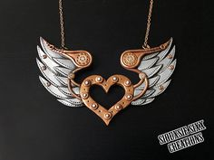 Nery Necklace. Copper and Silver Steampunk Winged Heart Pendant Made of Polymer Clay.