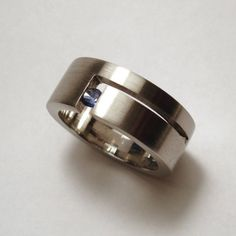 Stainless steel and blue sapphire