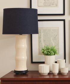 navy lamp and framed city maps