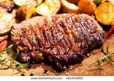 grilled meat with rosemary on wooden board