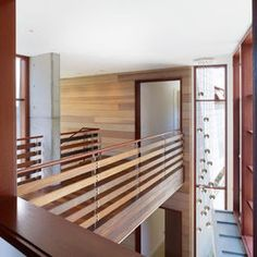 Wood railing design hall modern with wood railing modern railing wood railing Indoor Stair Railing, Loft Railing, Modern Railing, Balcony Railing Design, Staircase Railings, Modern Stairs, Railing Ideas, Modern Hall, Banisters
