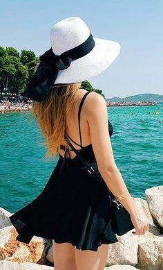 #summer #fashion / black fit and flair dress