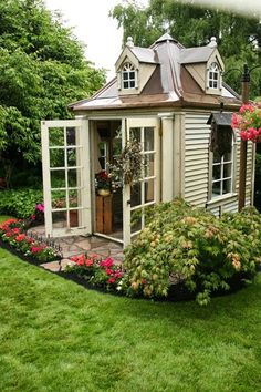 Charming little garden house-- I can't keep a fake plant alive, but I would find something perfect to put in there!