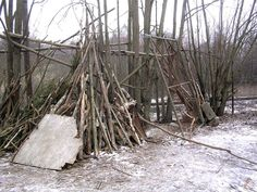 Adventure play with branches and other loose parts, - on the school buildings backsite. Kjelsås primary school - Oslo.