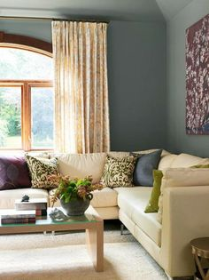 Gray, cream and purple are a winning purple color combination that always works well. This room shows a lot of depth on the walls, and then is still light with the addition of the cream colored sofa and draperies.