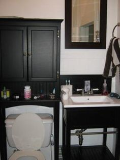 Bathroom Cabinets Over Vanity cabinet above toilet, horizontal striped wallpaper | wash: laundry