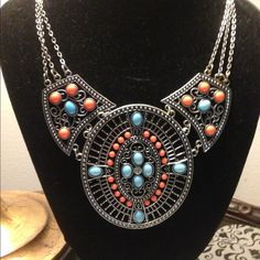 Turquoise and Coral Ethic style necklace Gorgeous antique silver medallions with turquoise and coral colored stones embellish this awesome necklace! Lays beautifully! Jewelry Necklaces