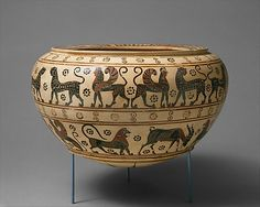 Terracotta dinos (mixing bowl)  Attributed to the Polyteleia Painter     Period:      Transitional  Date:      ca. 630–615 B.C.  Culture:      Greek, Corinthian  Medium:      Terracotta  Dimensions:      H. 7 1/4 in. (18.4 cm); diameter 12 in. (30.5 cm)  Classification:      Vases