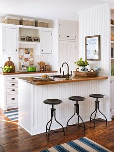 White is always a great choice for a small country-style kitchen. Warm wood flooring prevents the room from feeling sterile, while an abundance of beaded board lends texture and charm./