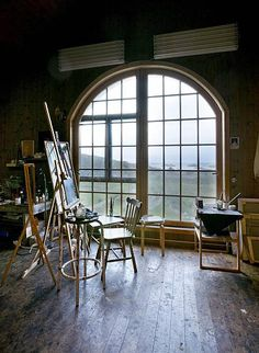 Lucky artist owns this studio with the sea in the distsnce