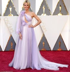 Taking a bold risk: Heidi Klum turned heads in a very unusual lilac and white gown with cut-out section on the chest