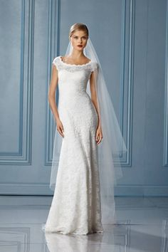 Bateau neckline, fitted bodice, soft a-line skirt, lace covered buttons to top of zipper and sweep train.