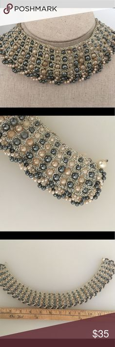 Vintage Beaded Pearl Choker This is a gorgeous vintage pearl beaded choker. Measures 14 inches in length with a pearl fastener. . It has bluish gray pearls interspersed with off white pearls Tiny silver beads wrap the pearls. Very light and comfortable to wear Vintage Jewelry Necklaces