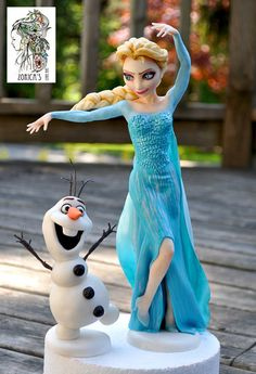 They made from fondant with tylose. Elsa's size is matches...