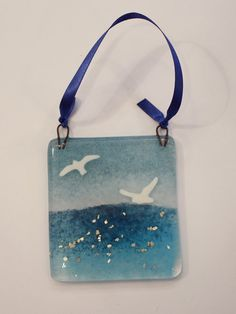 Hand made glass seagull hanging with silver flecks in the sea. Shoulder Bag, Trending Outfits, Unique Jewelry, Glass, Handmade Gifts, Etsy, Vintage, Ideas, Fashion