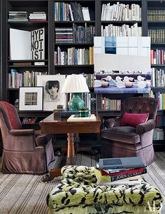 In the New York City home of Jenny and Trey Laird, a Louise Lawler photograph of lightbulbs presides over the library of a Manhattan townhouse decorated by Jeffrey Bilhuber; the desk is 19th-century English.