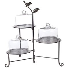 Three-tier metal dessert stand with three glass domes.    Product: 3 Tier cake stand    Construction Material: Metal a...