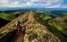 "São Miguel Island, Portugal  Nicknamed ""the green island"", this volcanic Azorean paradise is a must. Lakes located in the extinguished volcanic craters can be explored by a canoe or a kayak. The dramatic vistas and flora and fauna via 24 different hiking"