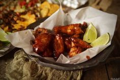 Brace yourselves. These Sriracha & Bourbon Chicken Wings are on point for your next finger food happy hour! Grab some napkins, you're going to need them.