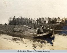 """Captioned: """"A canal barge on the Grand Union Canal between Uxbridge and Denham locks. Canal Barge, Canal Boat, Love Canal, London Transport Museum, Narrowboat, Old Images, Historical Images, Old London, London Life"""