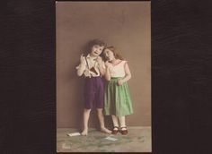 Children eating chocolate hand tinted postcard Boy & girl