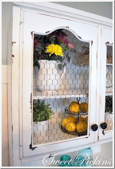 Glassed replaced with chicken wire. Love this look