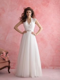 2810  Keep it sweet in our A-line gown — complete with lacy cap sleeves and a delightful keyhole back.