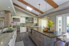 """Transitional kitchen with distressed wood. Like granite (""""Wild Sea"""") with rolled steel island and combo distressed wood."""