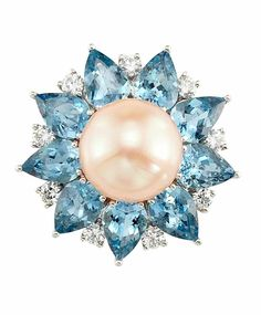 Platinum, Freshwater Peach Pearl, Aquamarine and Diamond Ring One pearl ap. 11.5 mm., 9 pear-shaped aquamarines ap. 5.75 cts., 9 round diamonds ap. .55 ct