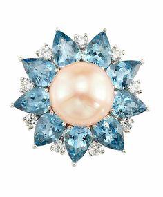 Platinum, Freshwater Peach Pearl, Aquamarine and Diamond Ring One pearl ap. 11.5 mm., 9 pear-shaped aquamarines ap. 5.75 cts., 9 round diamonds ap. .55 ct