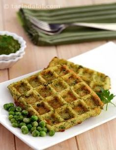 Green pea waffles look good, taste good, and are nutritious too – the perfect features to please people of all ages! this wholesome snack is prepared with readily available ingredients like green peas, semolina and urad dal flour. In fact, if urad dal flour is not available, you can even substitute with rice flour. Cooking the batter in a waffle iron gives it the required crispness and also makes it look fantastic. Just ensure you serve it fresh, with perky green chutney, a dollop of honey…