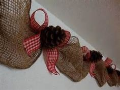 Rustic Christmas garland...love this idea! Maybe with some lights? Different ribbons for the bows?