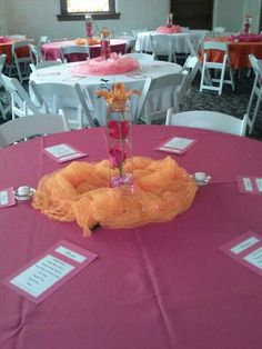 Pink and orange wedding idea. Three fresh hot pink roses submerged in water, orange asiatic Lilly