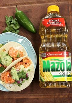 Grilled Shrimp Tacos with Creamy Cilantro Avocado Topping. Grilling season is here! These Grilled Shrimp Tacos with Creamy Cilantro Avocado Topping provide an explosion of flavors for the taste buds! You'll be hooked at bite one! #ad #MarinadesWithMazola #MakeItWithHeart