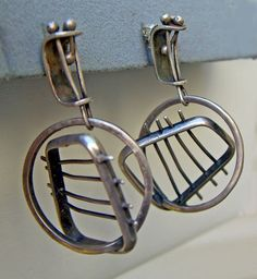 Earrings by Ed Wiener, c1950s.  Sterling silver. The placement of the barred rectangles create a sense of motion.