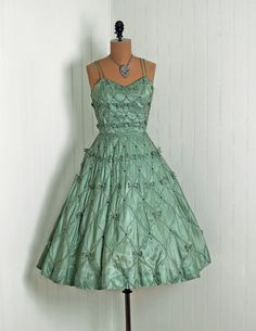 Such a GORGEOUS dress. I love all of the little bows and the color. Wouldn't it be great for a Christmas party? $325
