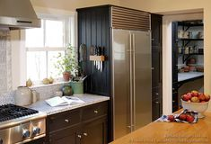 #Kitchen Idea of the Day: Traditional black kitchens gallery. (By Crown Point Cabinetry). Nice, black early american built in refrigerator