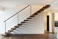 Beautiful modern loft staircase with minimalist handrail and no stringer  http://www.inspiredhomeideas.com/modern-home-staircase-designs/