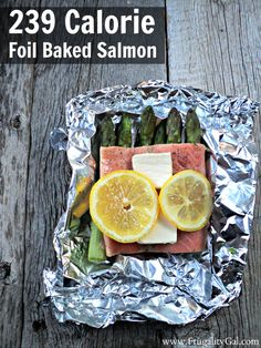 Easy Dinner Recipe Idea : 239 calorie baked salmon recipe with asparagus. This 30 minute meal is a healthy  recipe and requires zero cleanup since the salmon is baked in foil pouches.