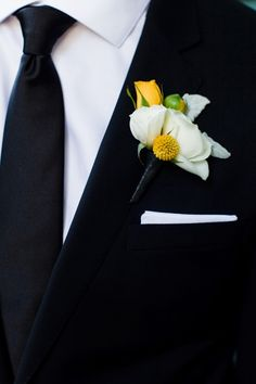 White and yellow looks fabulous on a dark suit lapel
