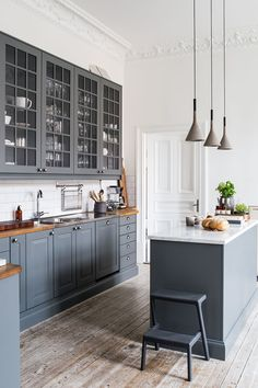 Possibly gray bottoms with white uppers instead. Like the butcher block countertop with the