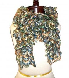Crocheted Ruffled Scarf    Ruffled Scarf in rich shades of Ultramarine Green, Honey Gold and Olympian Blue. All this years Fall Color Fashion Trends wrapped up into one! Beautiful Victorian Style scarf will jazz up any outfit this Fall and Winter Season! Scalloped edges add the perfect finishing touch to this beauty! Beautiful!    This is a very delicate scarf and I recommend you hand wash in woolite and lay flat to dry or Dry Clean Only to preserve its look and feel! You can read about here